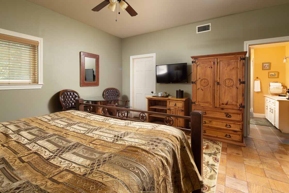 western themed room with green walls and yellow bathroom