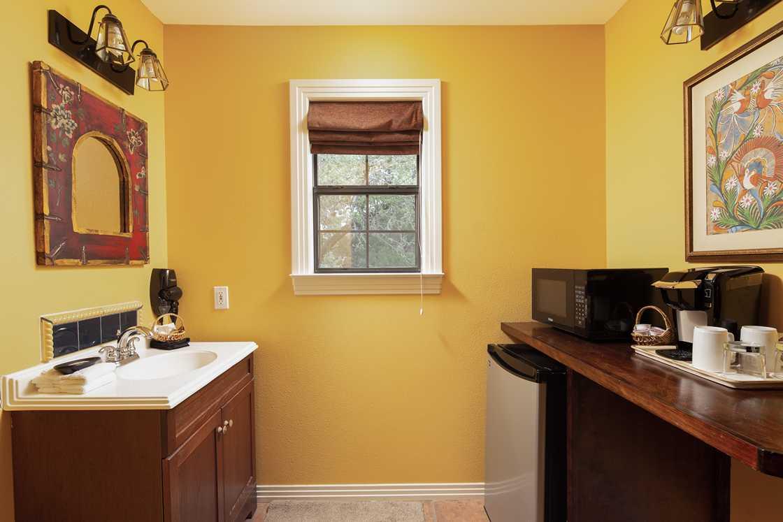 yellow bathroom with small window