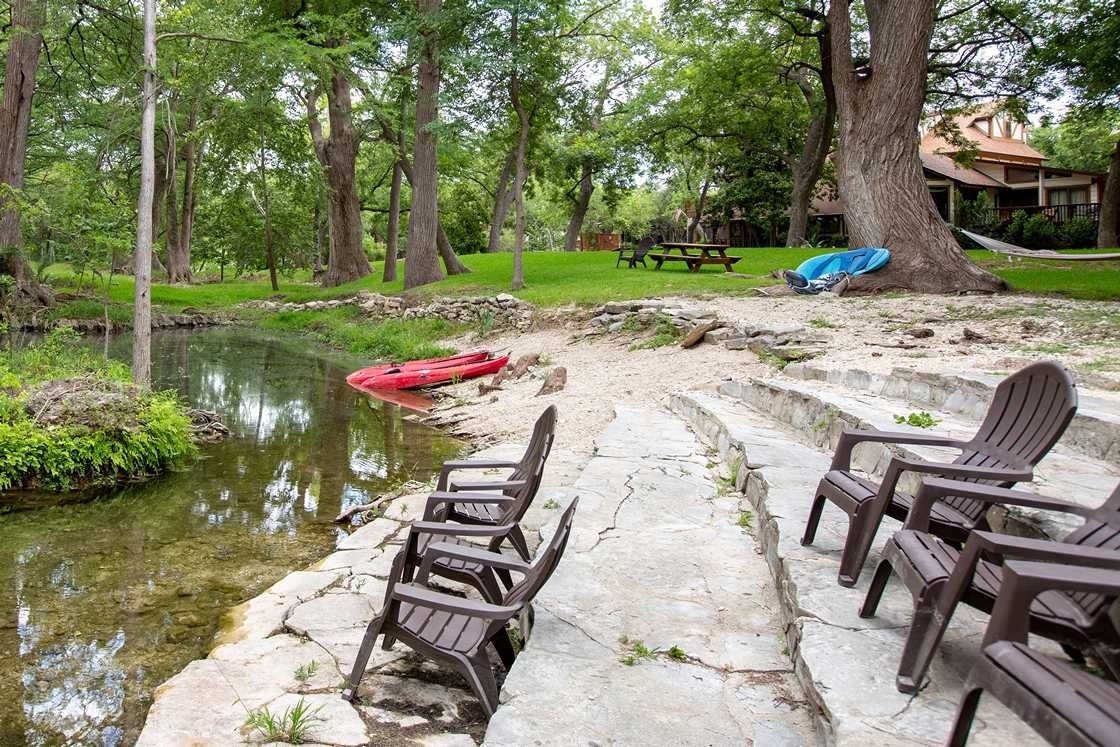 stone steps next to creek with kayaks