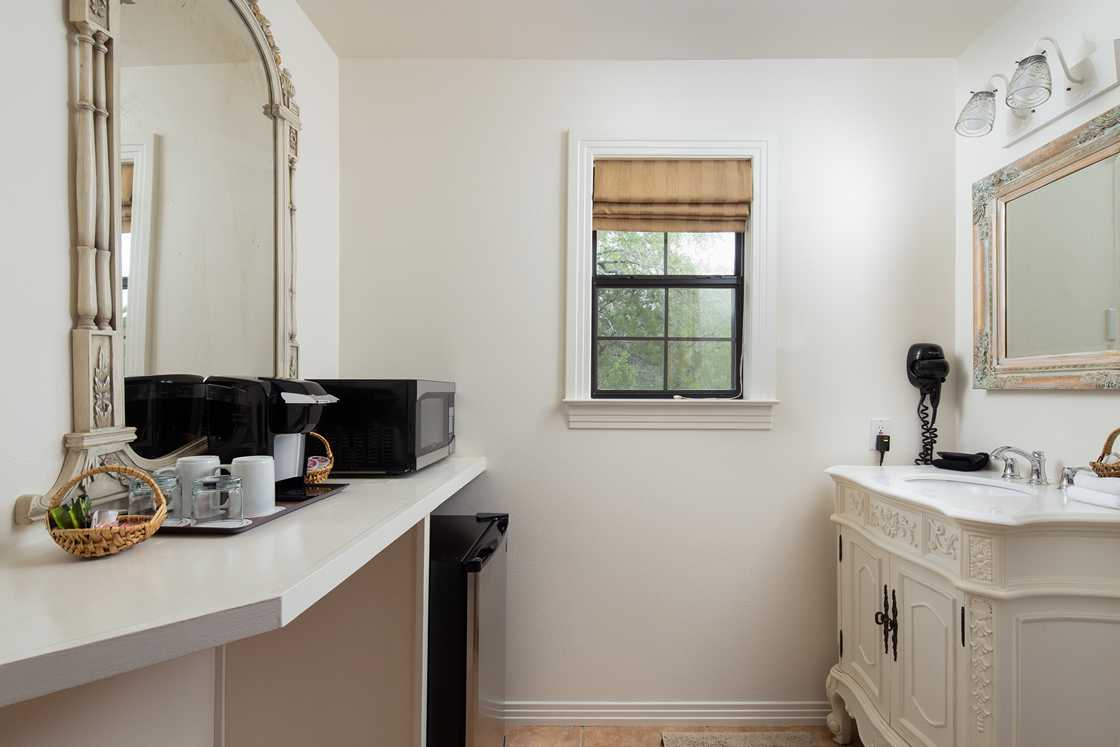 wide shot of a mostly white bathroom