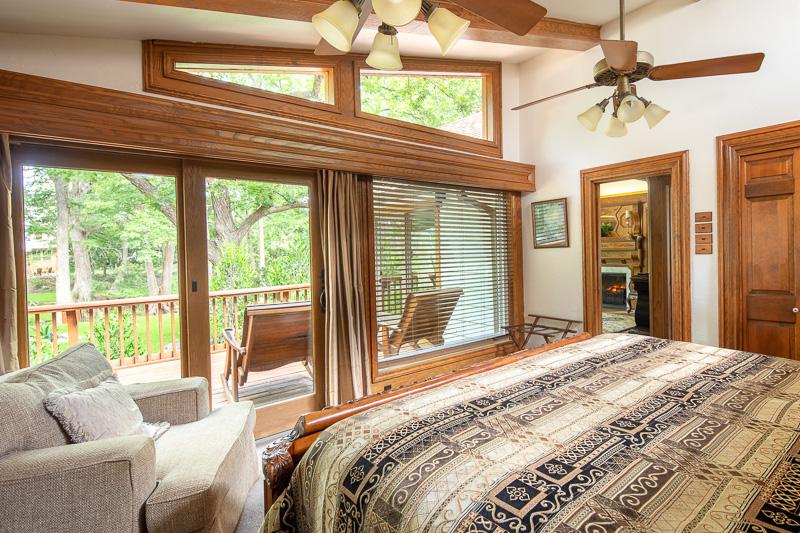 elegant bedroom with view of cypress creek