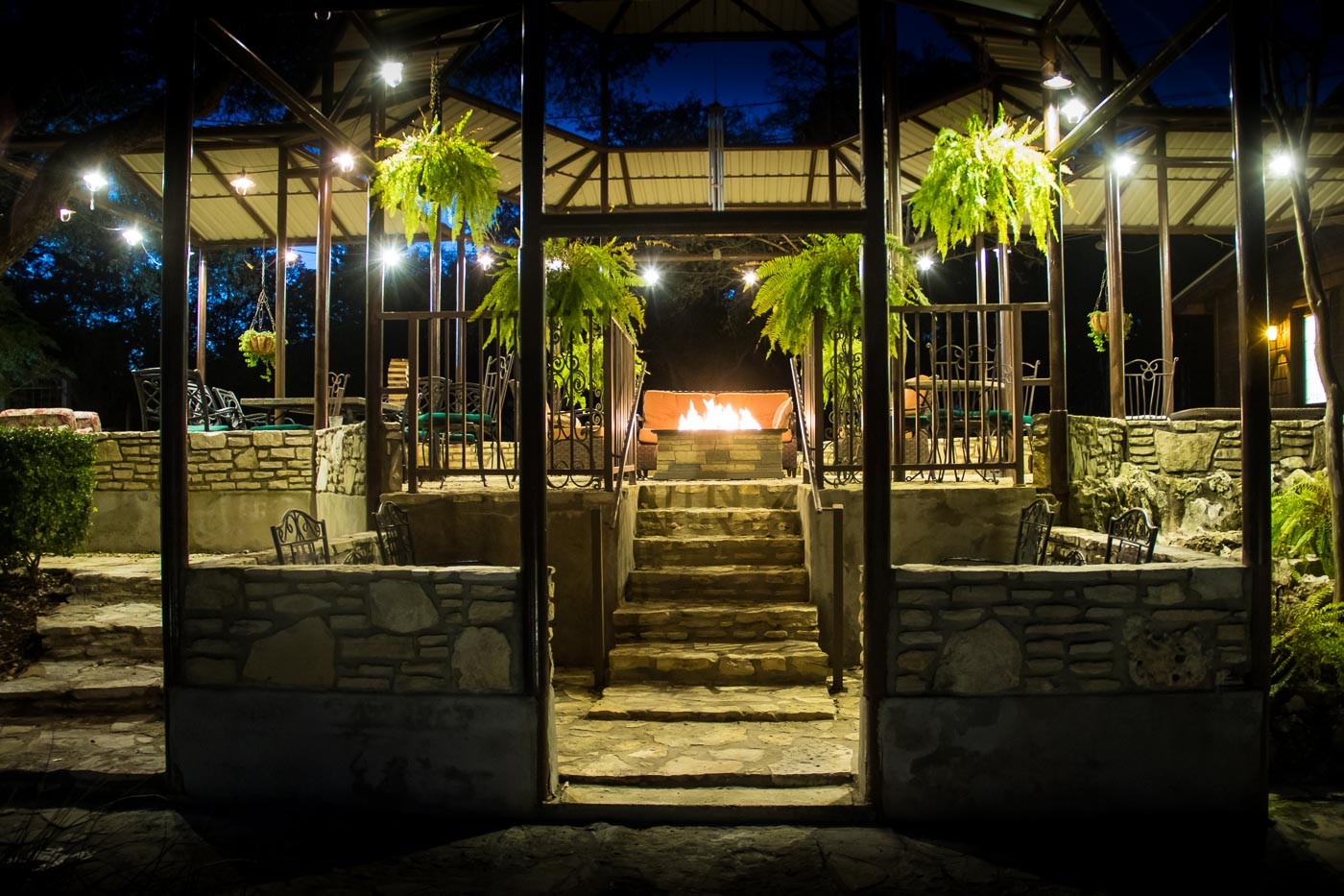 creekhaven greenhouse fire pit night view